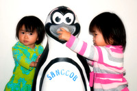Lily & Lienna Pose with a Penguin